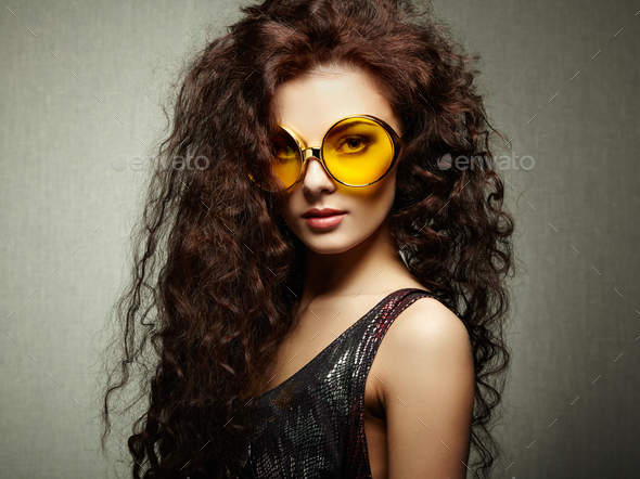 Portrait of beautiful woman in sunglasses on white background - Stock Photo - Images