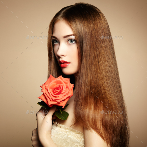 Portrait of beautiful dark-haired woman with flowers - Stock Photo - Images