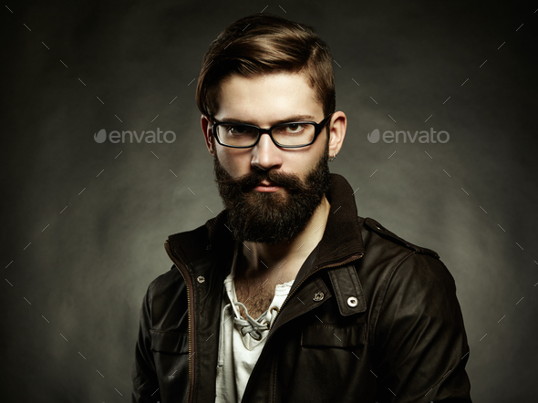 Portrait of man with glasses and beard - Stock Photo - Images