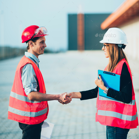 Handhaking on construction site - Stock Photo - Images