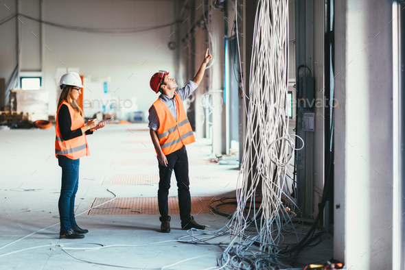 Maintenance Engineers checking cables - Stock Photo - Images