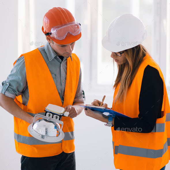 Maintenance Engineers checking light - Stock Photo - Images