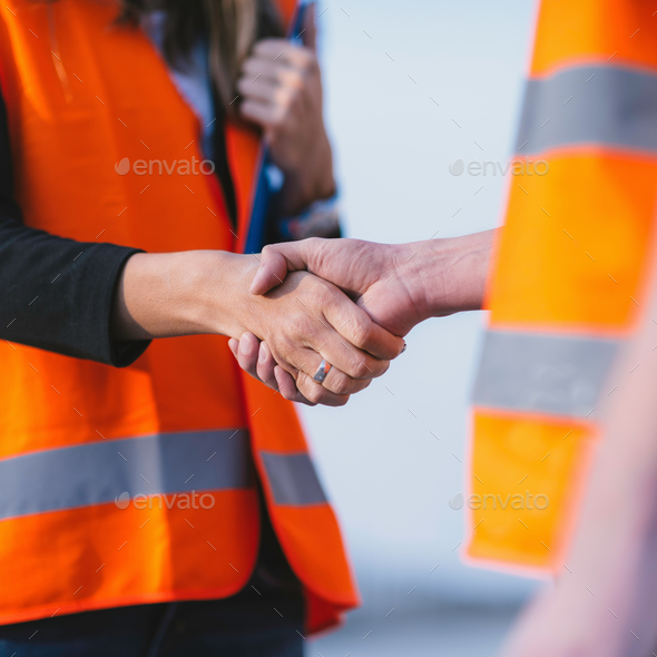 Engineers handshaking - Stock Photo - Images
