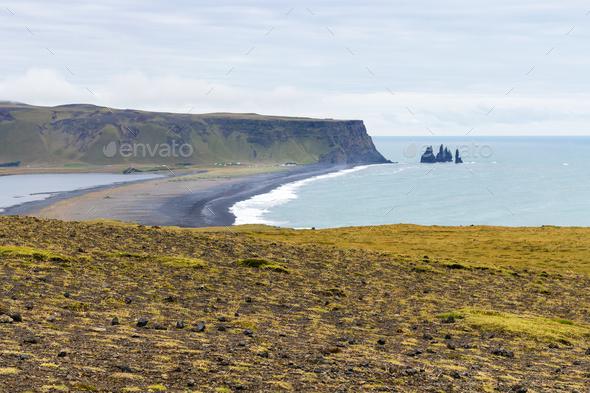 view of Kirkjufjara black beach from Dyrholaey - Stock Photo - Images