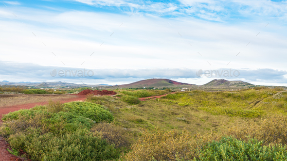 landscape with red volcanic soil in Iceland - Stock Photo - Images