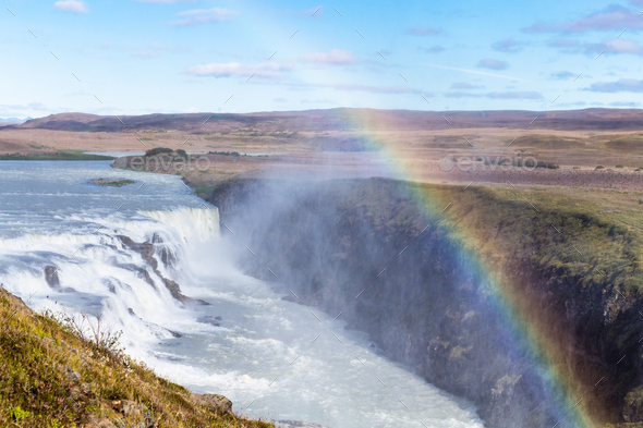 rainbow over Gullfoss waterfall in canyon - Stock Photo - Images