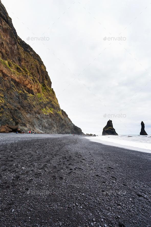 Reynisfjara Beach with Reynisdrangar mountains - Stock Photo - Images