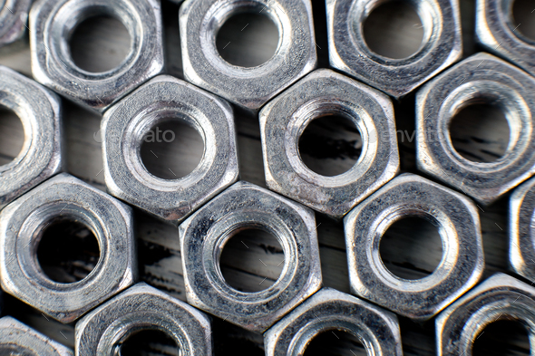 Metal nuts background. Macro. Working tools. Fixing elements. - Stock Photo - Images