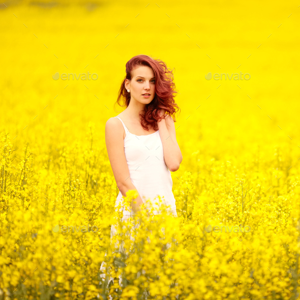 young beautiful girl in the field - Stock Photo - Images