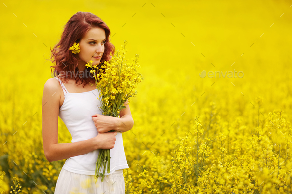 beautiful girl in the yellow field - Stock Photo - Images