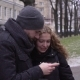 Young Beautiful Couple Is Using Phone in Autumn Park - VideoHive Item for Sale