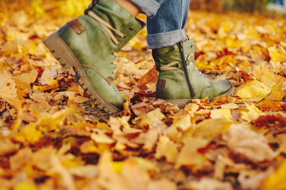 Leather shoes walking on fall leaves Outdoor - Stock Photo - Images