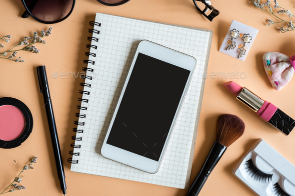 Blank notebook with Various makeup products and copy space - Stock Photo - Images