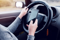 Woman simultaneously driving car and reading text message - PhotoDune Item for Sale