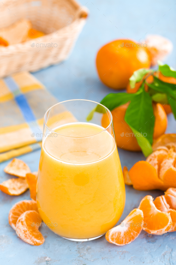Tangerines, peeled tangerines and tangerine juice in glass - Stock Photo - Images