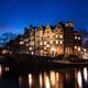 Amsterdam canal houses illuminated at dusk - PhotoDune Item for Sale