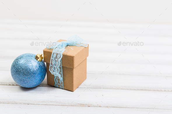 Gift box on old wooden background. - Stock Photo - Images