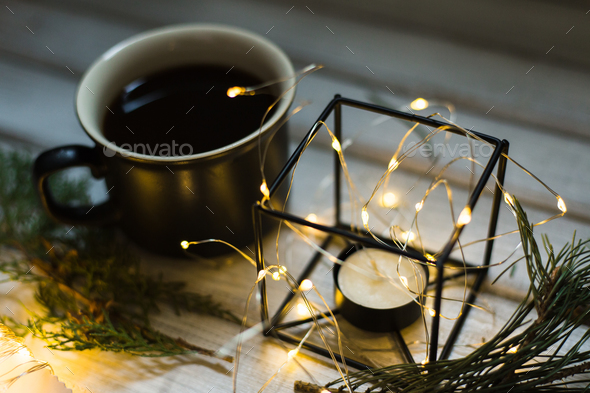 Christmas decor. Cup of coffee and candle - Stock Photo - Images