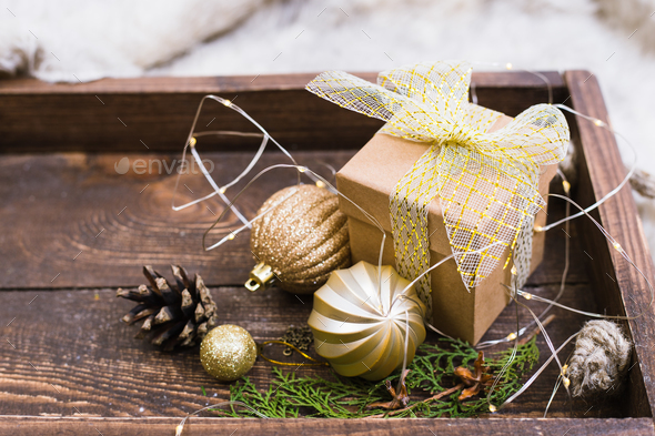 Christmas decoration with fir tree, gift box, garland lights, toys. Winter holidays. - Stock Photo - Images