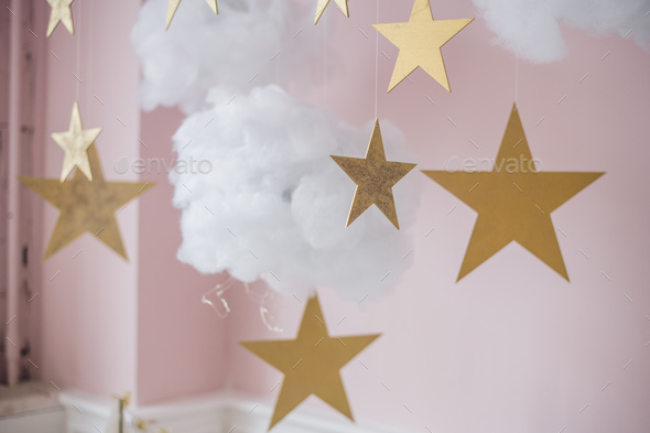 Cotton wadding clouds with stars on pink background - Stock Photo - Images