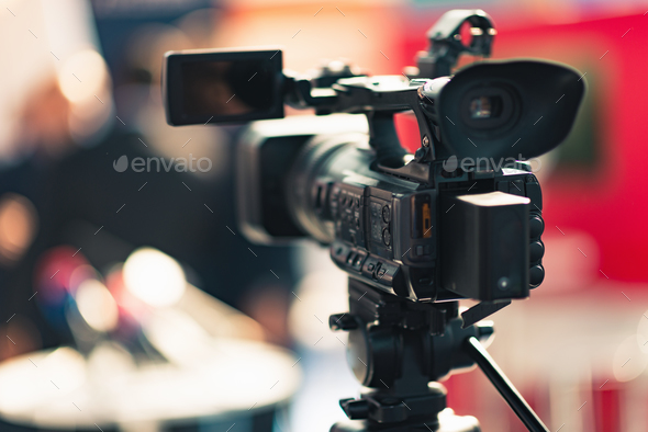 Camera recording publicity event - Stock Photo - Images