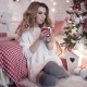 Xmas - Young Beautiful Woman Drinks Tea Near a Christmas Tree - VideoHive Item for Sale