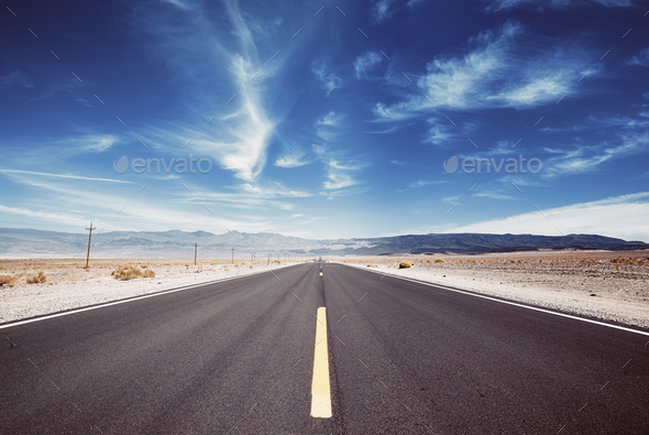 Desert road in the Death Valley, USA. - Stock Photo - Images