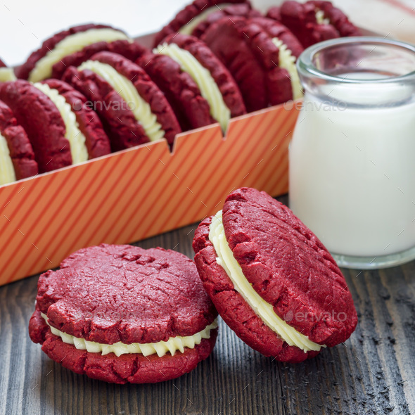 Red velvet sandwich cookies with cream cheese filling on wooden table, square format - Stock Photo - Images
