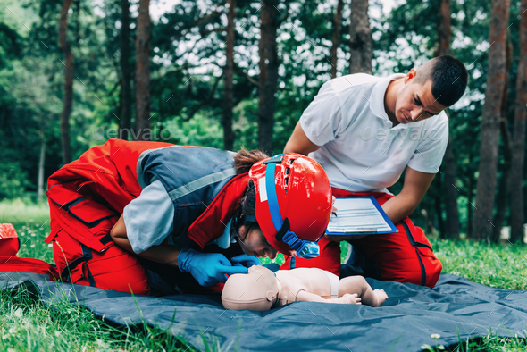 Cpr training on baby dummy - Stock Photo - Images