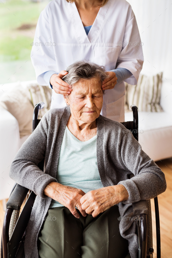 Health visitor and a senior woman during home visit. - Stock Photo - Images