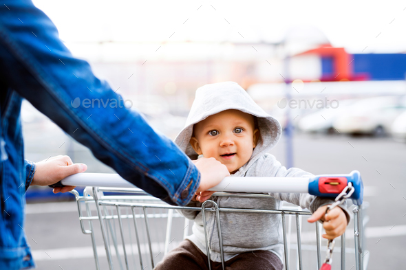Mother with baby boy in the car park, going shopping. - Stock Photo - Images