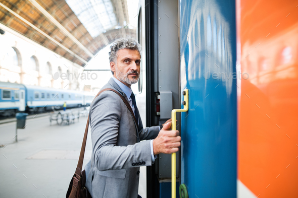 Mature businessman on a train station. - Stock Photo - Images