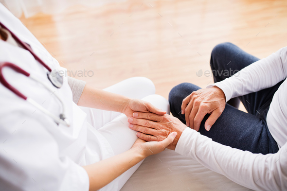 Health visitor and a senior man during home visit. - Stock Photo - Images