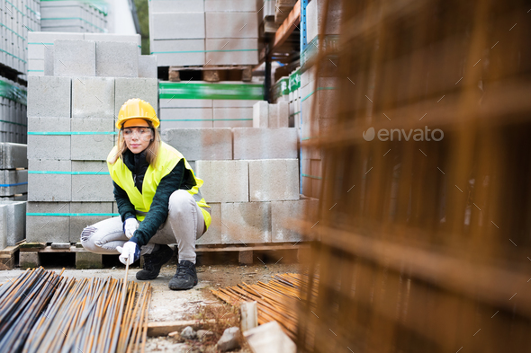 Young woman worker in an industrial area. - Stock Photo - Images