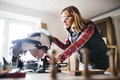 Young woman worker in the carpenter workroom. - PhotoDune Item for Sale