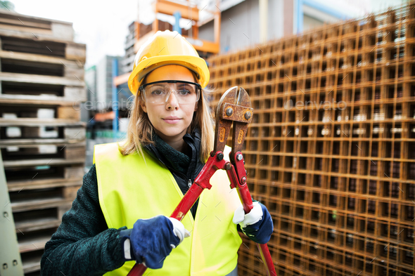 Young woman worker with large bolt cutters. - Stock Photo - Images