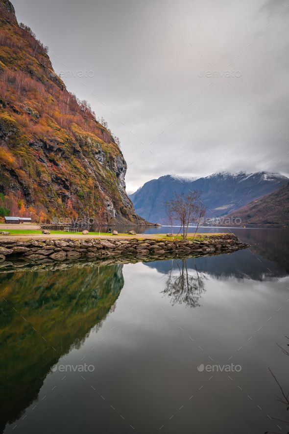 Stunning scenery of norwegian fiord as seen from the shore - Stock Photo - Images