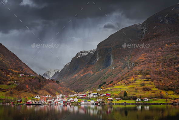Small homes on the shore of a fjord - Stock Photo - Images