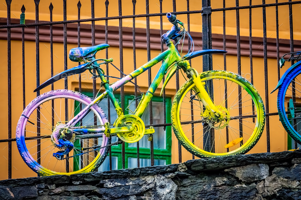 Old rusty colourfully painted vintage bicycle - Stock Photo - Images