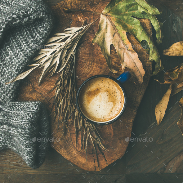 Autumn morning coffee concept with leaves and sweater, square crop - Stock Photo - Images