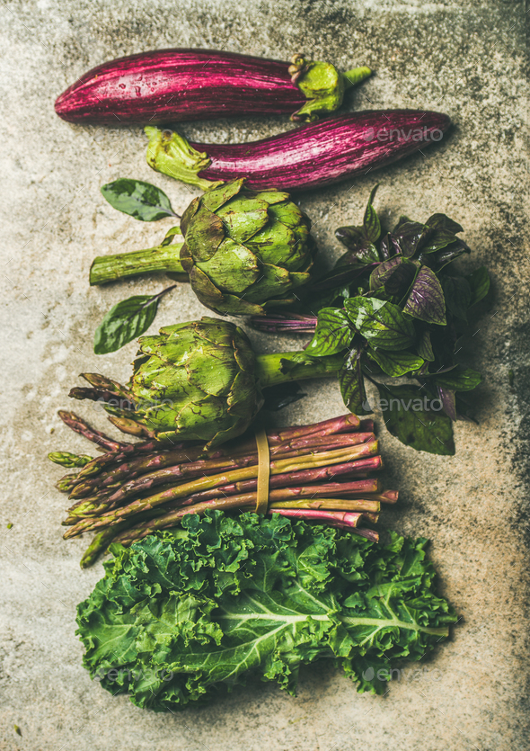 Flat-lay of fresh green and purple vegetables, vertical composition - Stock Photo - Images