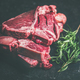 Raw beef meat t-bone steaks with rosemary on black background - PhotoDune Item for Sale