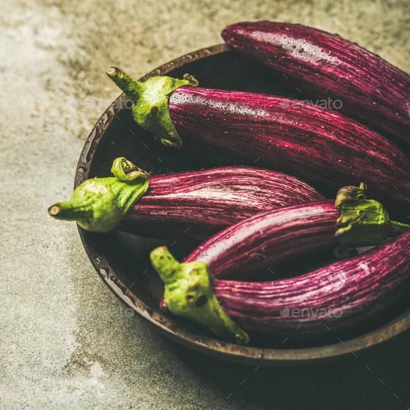 Fresh raw Fall harvest purple aubergines, square crop - Stock Photo - Images