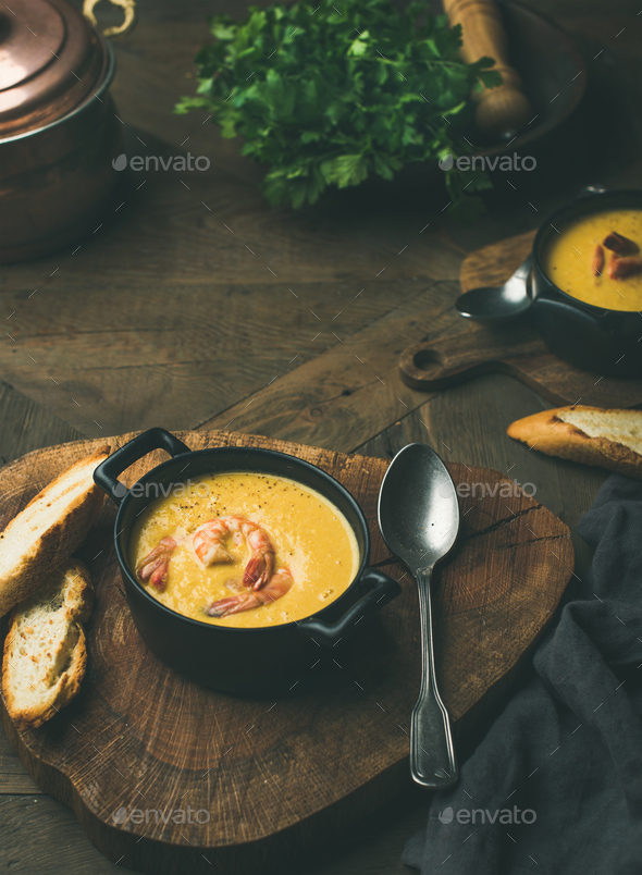 Corn creamy soup with shrimps served in individual pots - Stock Photo - Images