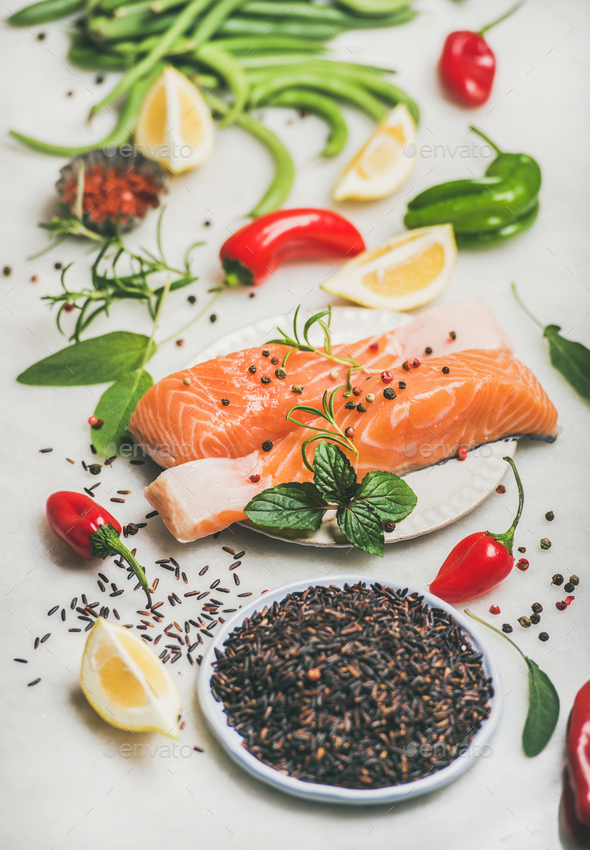 Raw salmon steaks with vegetables, greens and rice, marble background - Stock Photo - Images