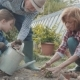 Senior Couple with Grandaughter Gardening in the Backyard Garden - VideoHive Item for Sale