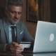Mature Businessman with Laptop in a Hotel Lounge - VideoHive Item for Sale