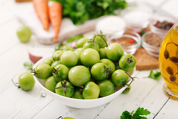 Ingredients for Korean salad from green tomatoes and carrots. - Stock Photo - Images