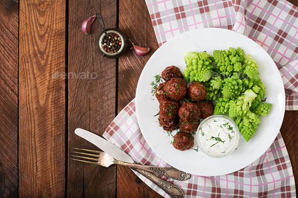 Baked beef meatballs and garnish from boiled cabbage romanesko - Stock Photo - Images