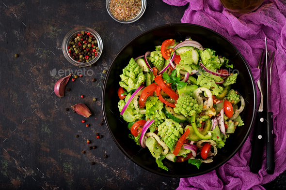Vegan salad of fresh vegetables and cabbage romanesko - Stock Photo - Images